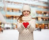 christmas, holidays, childhood, presents and people concept - dreaming girl in winter clothes with r