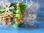 Christmas still life with decorations and wooden snowflakes on a blue background