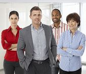 stock photo of work crew  - Diverse team of smiling office workers - JPG