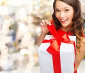 christmas, holidays, valentine's day, celebration and people concept - smiling woman in red dress wi