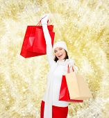 happiness, winter holidays, christmas and people concept - smiling young woman in white hat and mitt