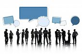 Silhouettes of Business People Talking and Speech Bubbles