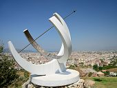 pic of sundial  - Image of a sundial displaying roman numerals overlooking the popular european tourist destination of Fethiye in Turkey with rppm for copy space - JPG