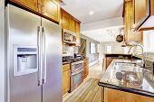 Kitchen Room With Black Granite Tops And Tile Back Splash Trim