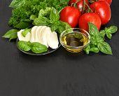 Fresh Basil, Tomatoes, Mozzarella And Olive Oil. Caprese Salad Ingredients