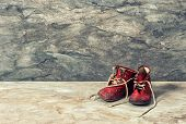Vintage Red Baby Shoes. Retro Style Toned Picture