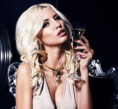 Portrait Of Sexy Woman With Blond Hair With Glass Of Champagne
