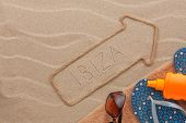 Ibiza Pointer And Beach Accessories Lying On The Sand