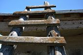 Old Wooden Ladder Pointed To The Sky