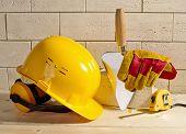 Brick Wall, Helmet And Trowel
