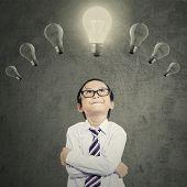 Creative Boy With Lightbulb Over Head