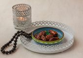 stock photo of nomads  - Ramadan lamp and dates on a white iron tray - JPG