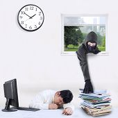 pic of felon  - Male thief with a mask take document through a window while the employee is sleeping - JPG