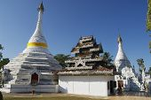 Unidentified person prays at the Wat Phra That Doi Kong Mu temple in Mae Hong S