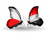 Two Butterflies With Flags On Wings As Symbol Of Relations Poland And Yemen