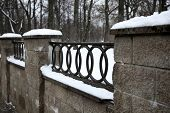 The Fence In The Park At Winter Time