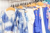 Fashionable blue and white clothes in the shop