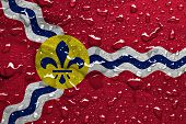 flag of St. Louis with rain drops