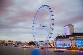 London eye in the night and south bank of river Thames