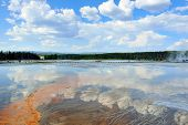 Midway Geyser Basin And Reflection Of Clouds In Yellowstone National Park, Wyoming