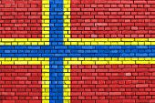 flag of Orkney painted on brick wall