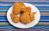 Fried Chicken On White Plate And Striped Towel