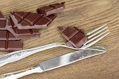 Slices Of Chocolate Bar With Silverware
