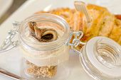 Appetizers With Salt Croissant And Anchovy Fillet Inside Glass Jar