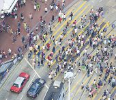 Commuters crossing a busy crosswalk Hong Kong