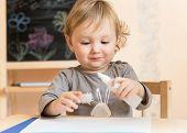 Little Boy Studies Glue