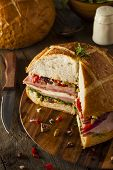 Cajun Muffaletta Sandwich With Meat And Cheese