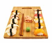 Sushi composition over cutting board