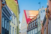 Narrow Street In The Old Town Of Tallinn With Colorful Facades