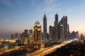 stock photo of dubai  - Dubai Marina Towers illuminated at night - JPG
