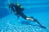 stock photo of watersports  - Learning to Scuba Dive in a Swimming Pool - JPG