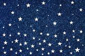White stars on blue glitter background
