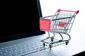 Internet Shopping Concept. Basket On Laptop Keyboard
