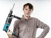 Young Man With Electric Drilling Machine Isolated On White