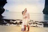 Bride And Groom Dance Barefoot On Sand Beach
