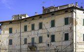 Pitigliano, Tuscany, old palace facade. Color image