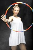 Young woman playing with a hula hoop. Color image
