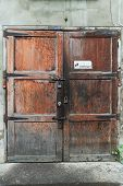 Old Closed Door With 3 Locks