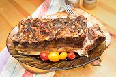 Barbecued Grilled Ribs Seasoned With Hot Spices And Tomatoes On A Dish On A Wooden Board