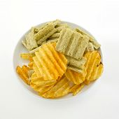 Mixed Potato Crisps And Corn Flake Cereal On White Background