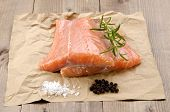 Fresh Salmon Fillet With Rosemary On Brown Paper