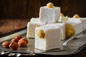Turkish delight. Eastern dessert with hazelnut on metal plate. Selective focus