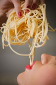 attractive woman with eating spaghetti.