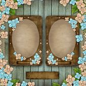Blue Wooden Background With 2 Vintage Frames, Flowers, Pearls And Lace