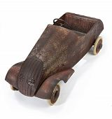 image of pedal  - Old childs toy pedal car well used now rusty on a white background - JPG