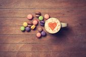 Cup And Macarons On Wooden Background